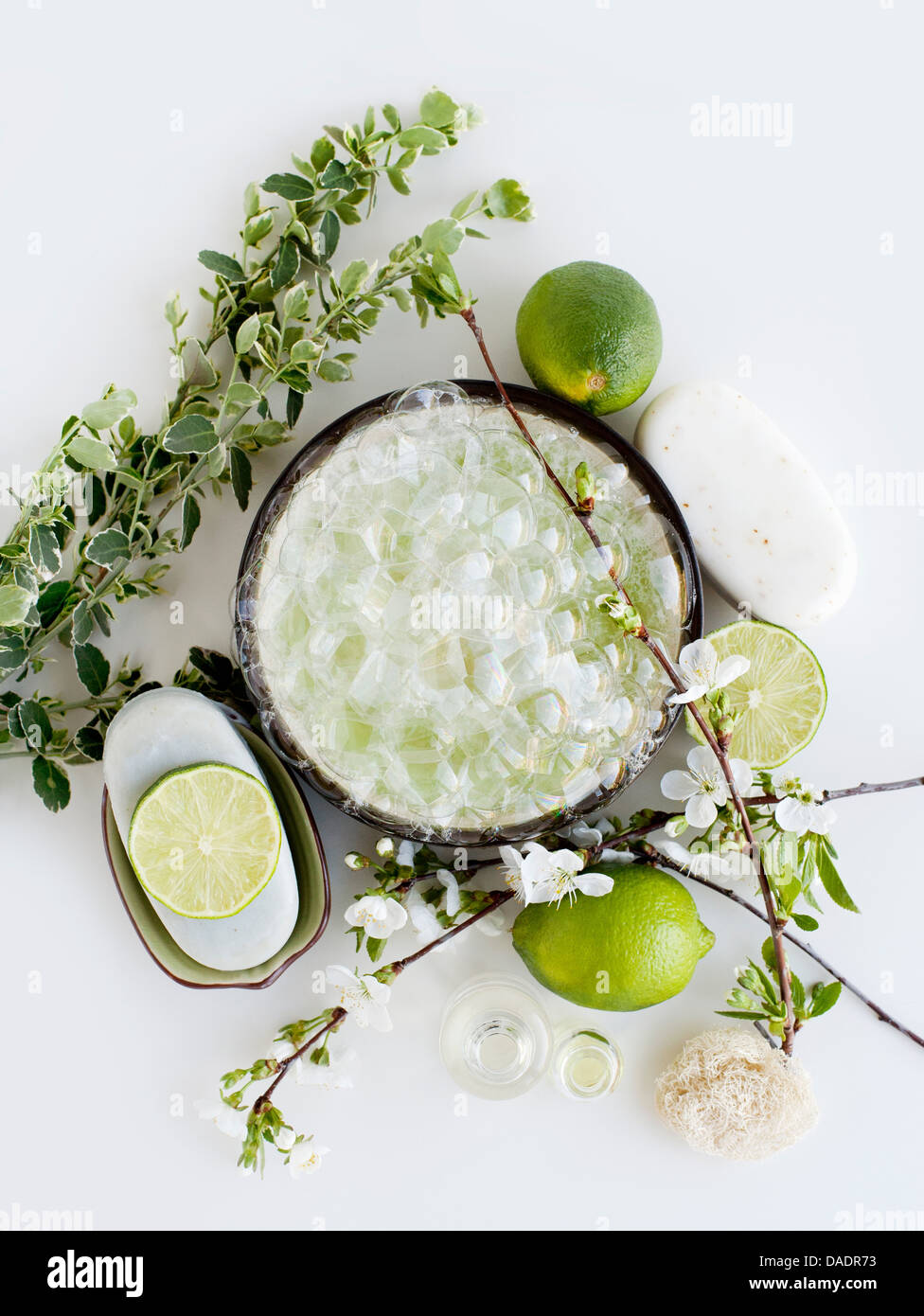 Aromatic still life with limes, blossom and soap - Stock Image