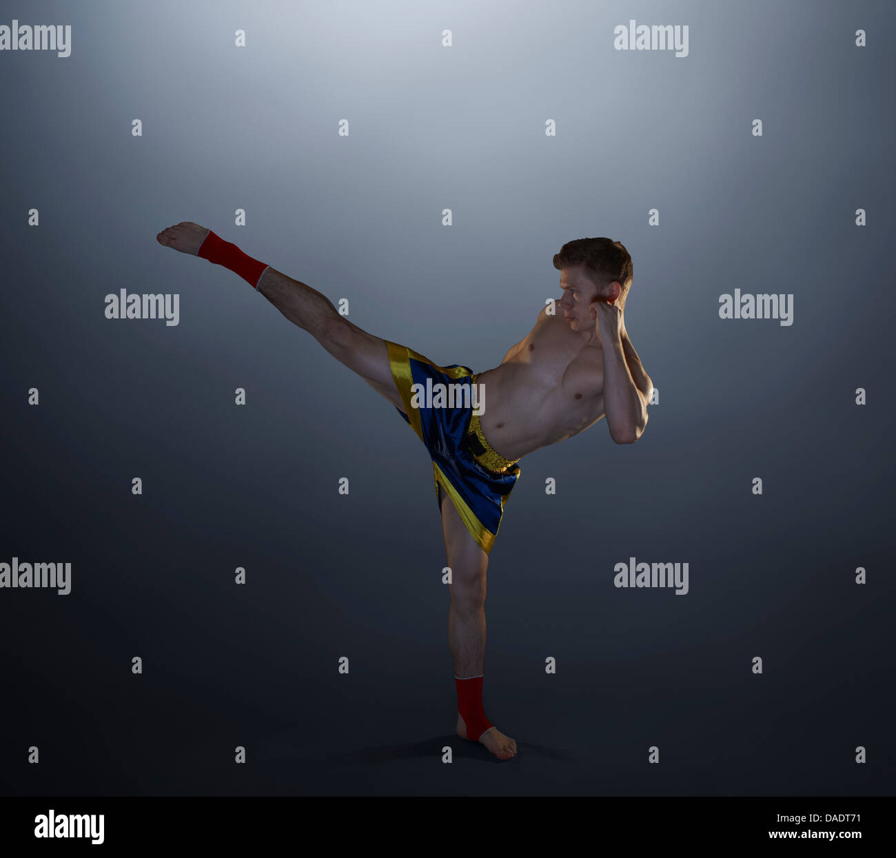 Studio shot of young male kick boxer - Stock Image