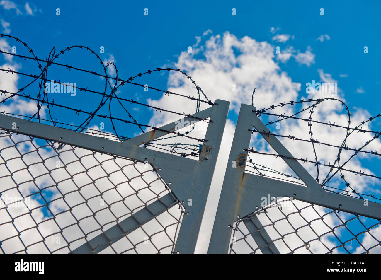 barbed wire fence and cloudy sky, Germany, Berlin - Stock Image