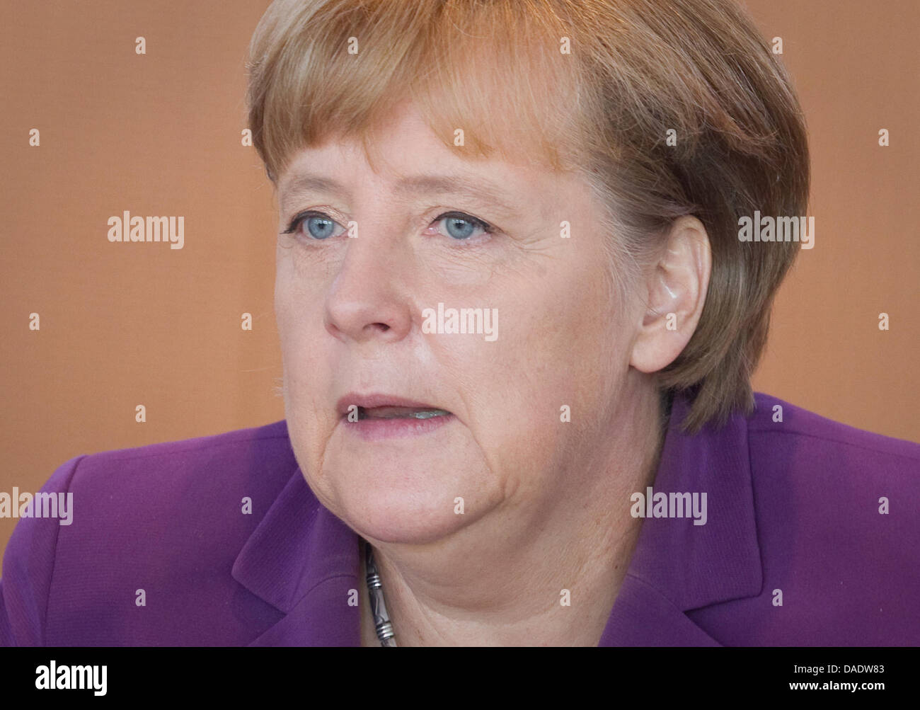 German Chancellor Angela Merkel (CDU) sits at the conference table awaiting the start of  the federal cabinet meeting Stock Photo