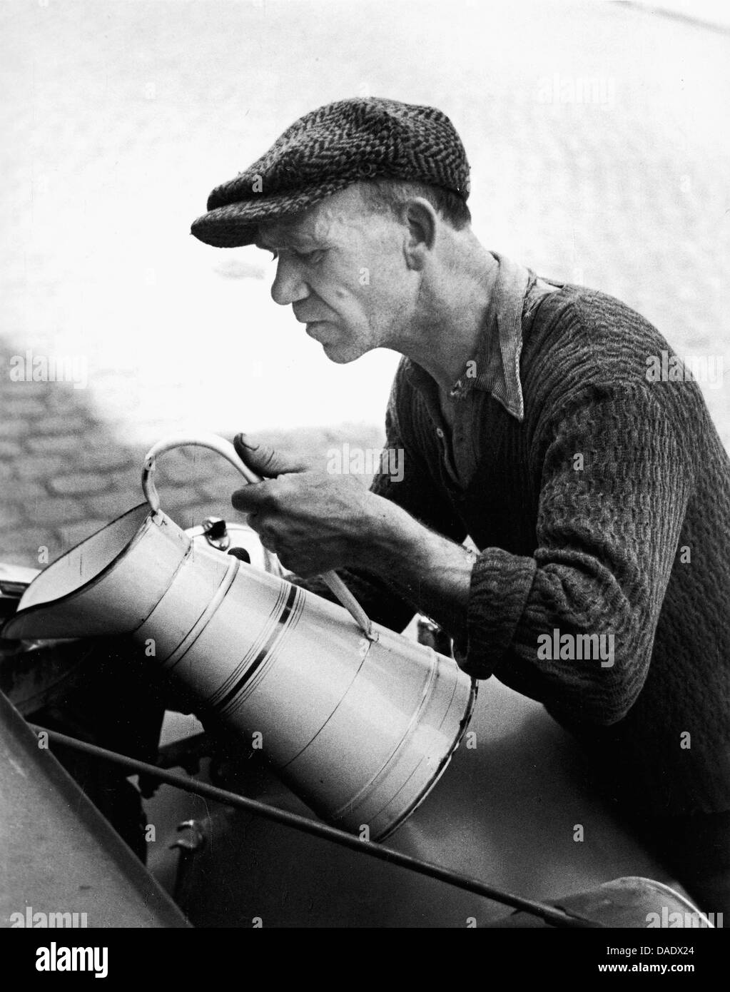 Water pitcher in 1935. Image by photographer Fred Stein (1909-1967) who emigrated 1933 from Nazi Germany to France Stock Photo