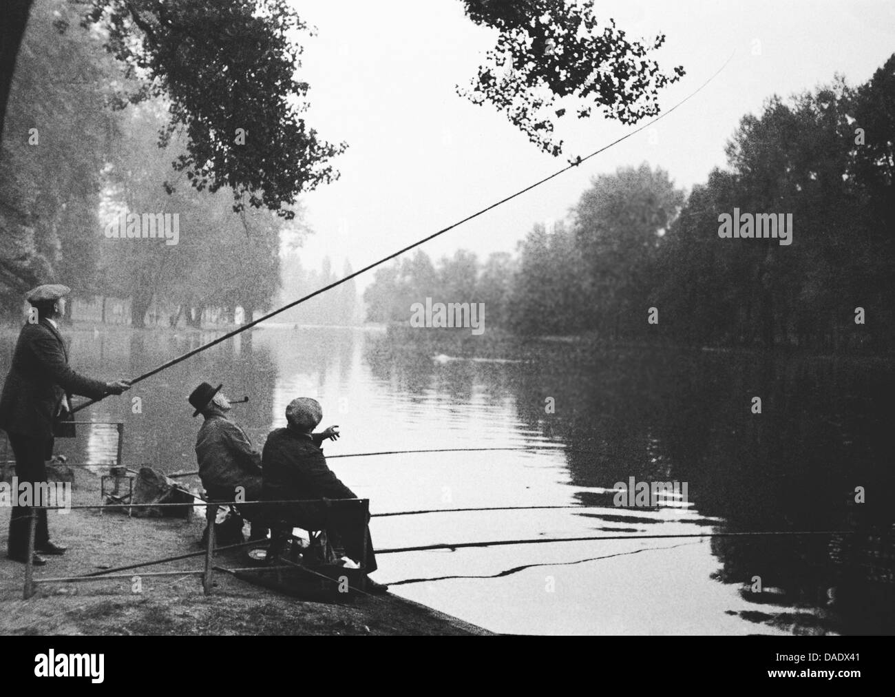 Paris 1934, men fishing. Image by photographer Fred Stein (1909-1967) who emigrated 1933 from Nazi Germany to France - Stock Image