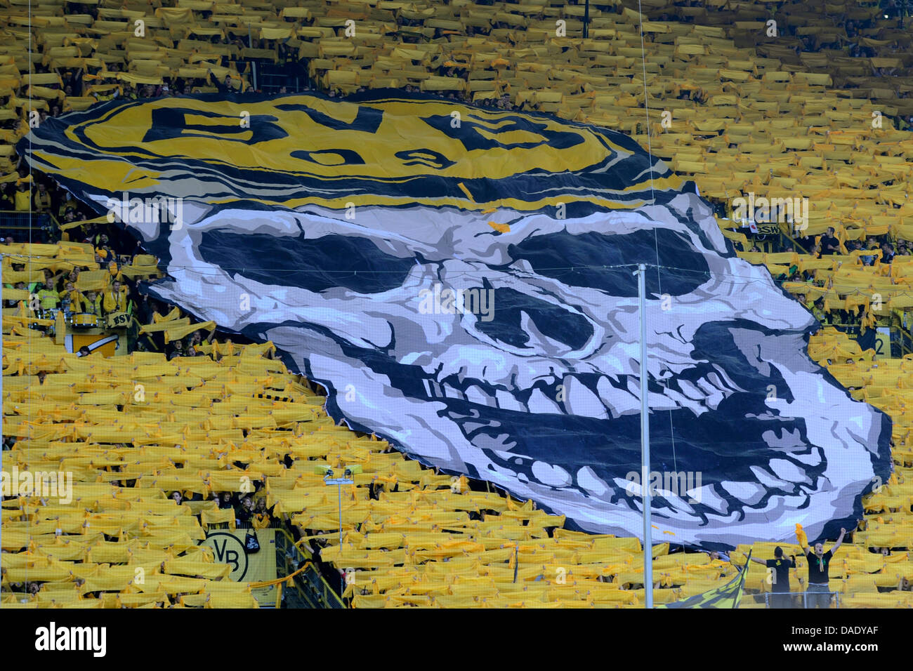 Fans Of Borussia Dortmund Display A Huge Banner Showing A Skull Stock Photo Alamy