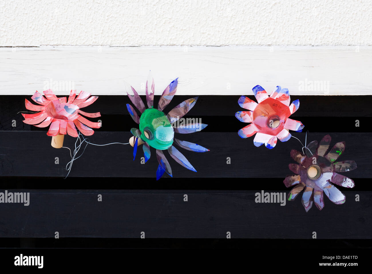 Recycling. Flowers made by children from recycled materials. - Stock Image