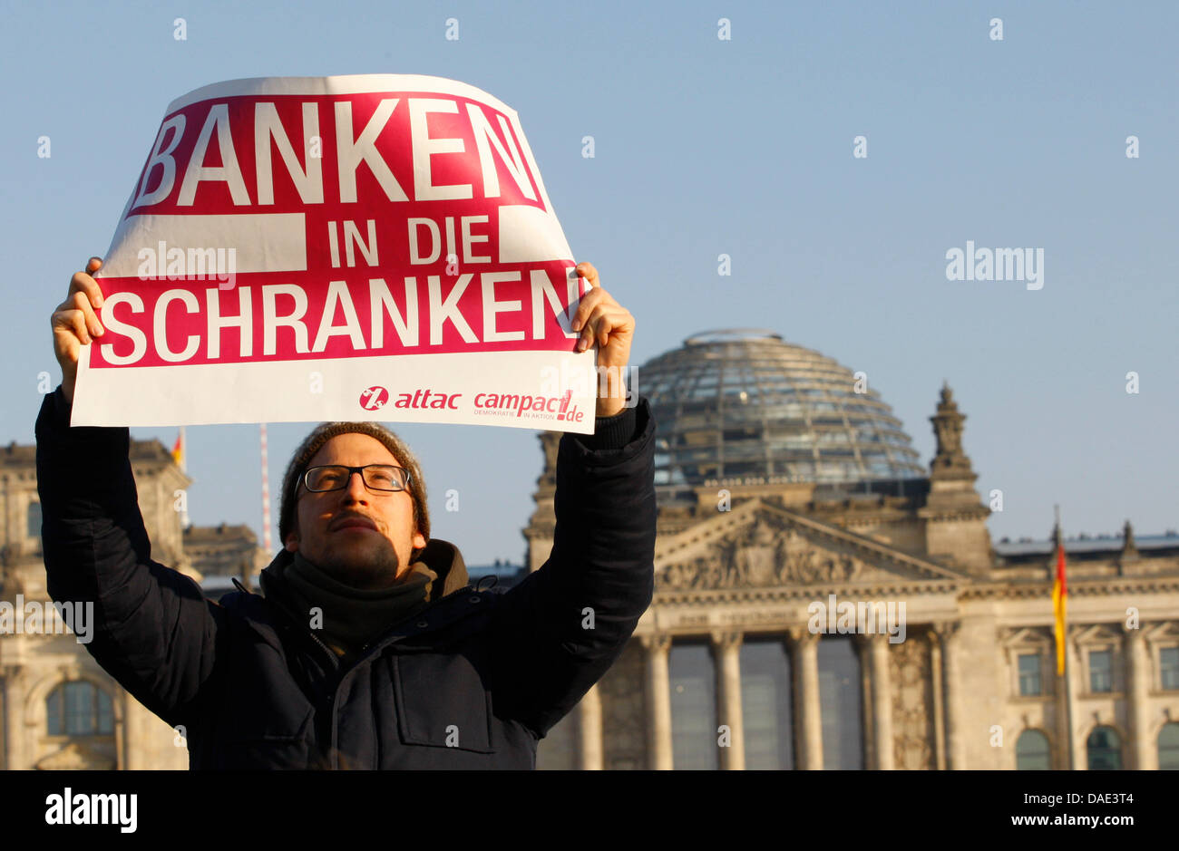 A protester carries a banner which reads 'Bar the Banks' (Banken in die Schranken) in Berlin, Germany, 12 November Stock Photo