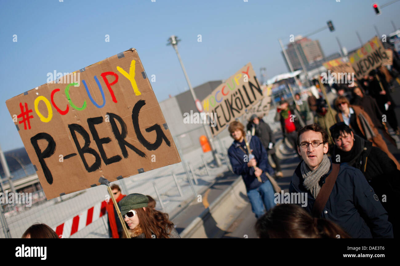 Protesters carry banners reading 'Occupy P-Berg' and 'Occupy Neukoelln' in Berlin, Germany, 12 November 2011. The Stock Photo