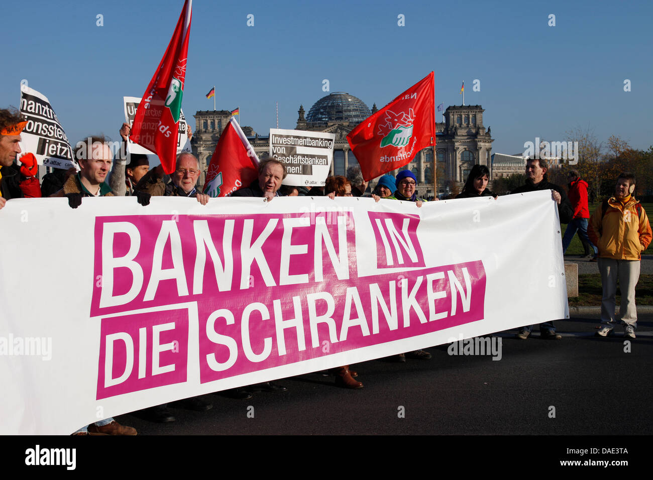 Protesters carry a banner which reads 'Bar the Banks' (Banken in die Schranken) in Berlin, Germany, 12 November Stock Photo