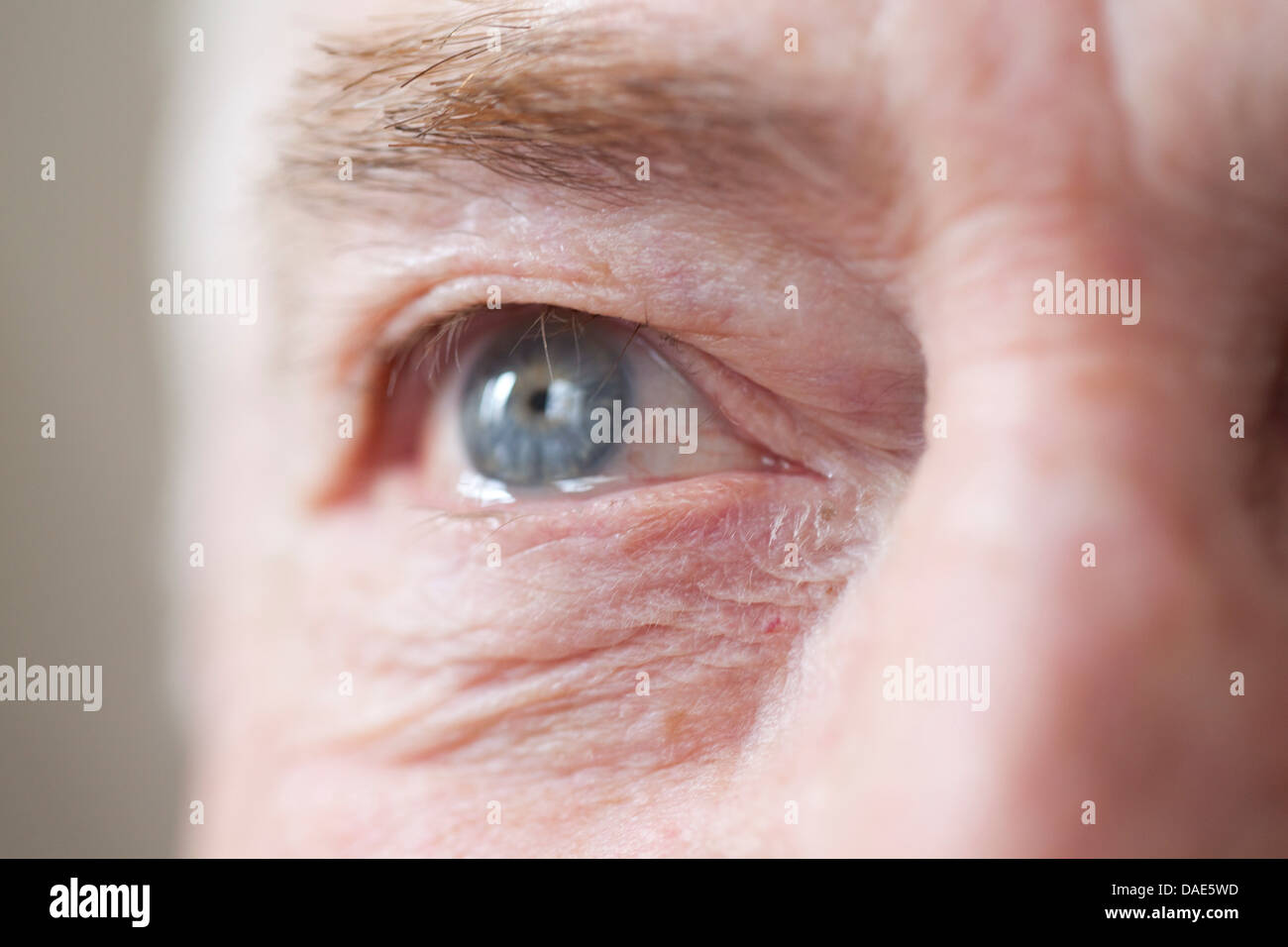 Senior man's eye, close up - Stock Image
