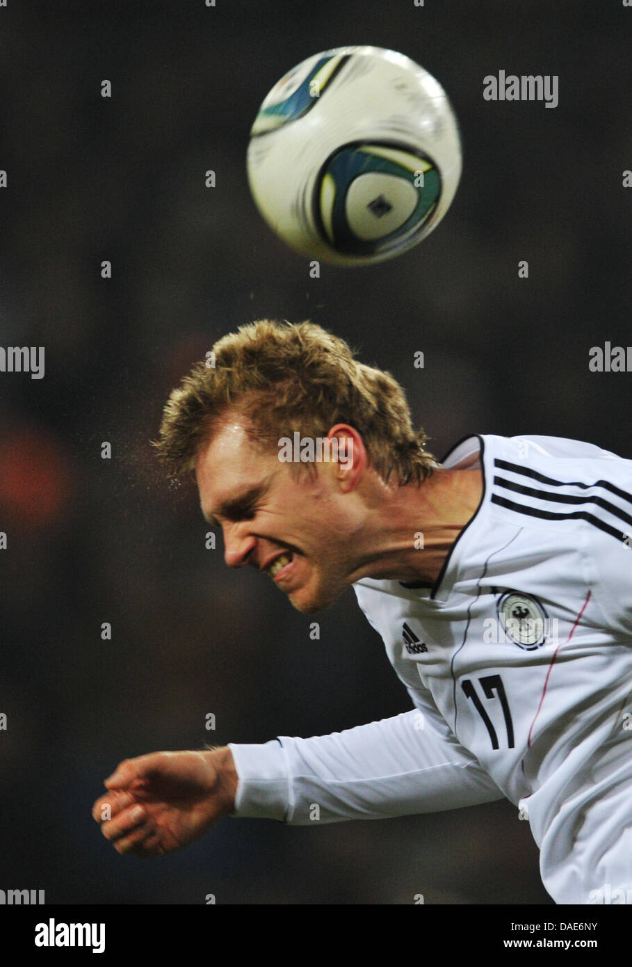 Germany's Per Mertesacker heads the ball during the international friendly soccer match Germany vs Netherlands at Stock Photo