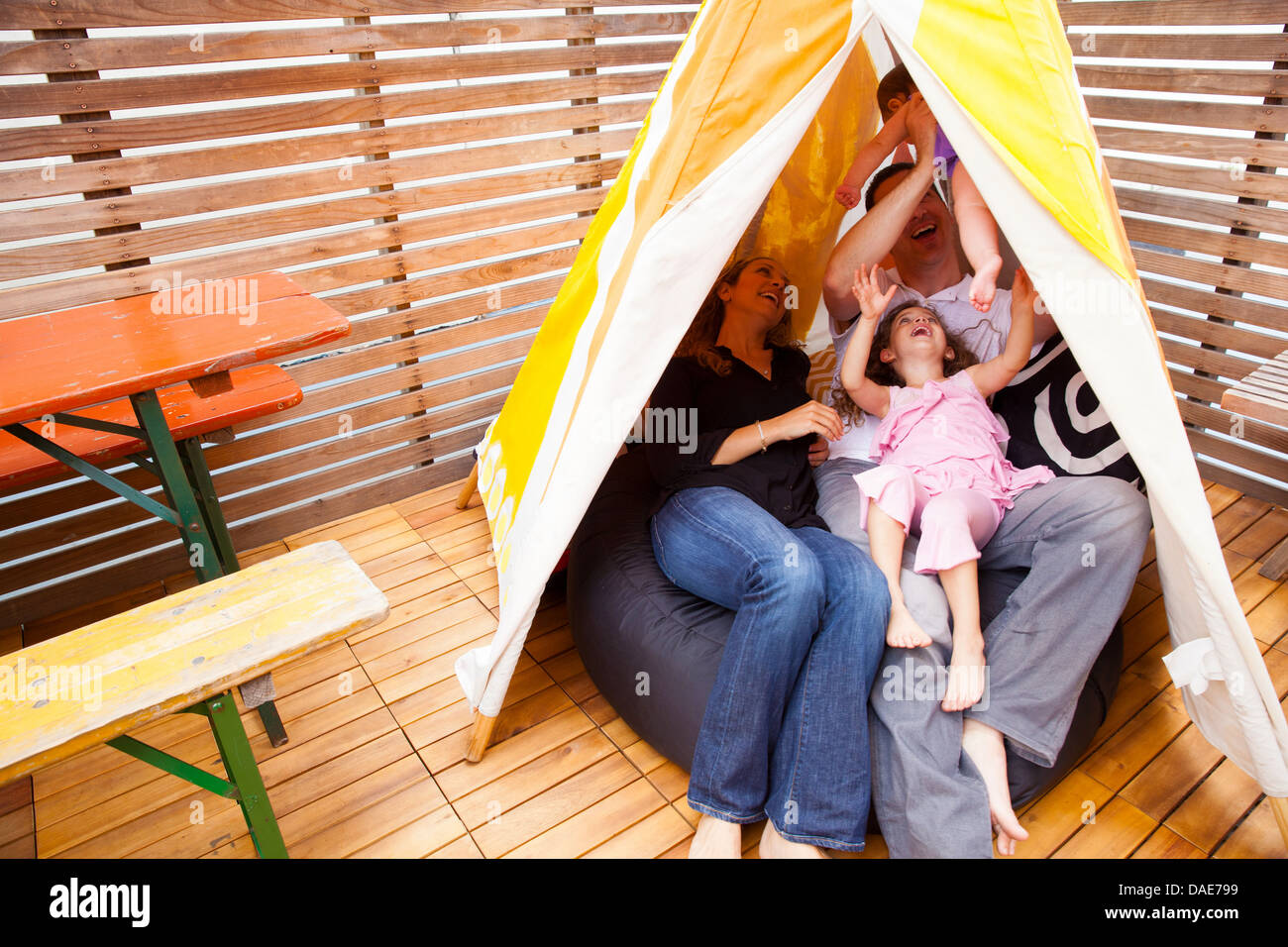 Family playing in tent - Stock Image