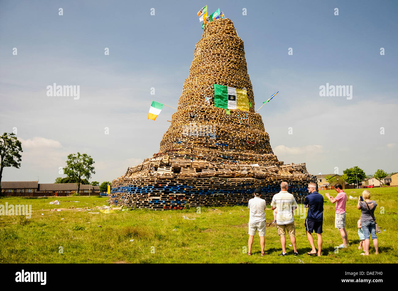 Newtownabbey, Northern Ireland. 11th July 2013. People gather to see an enormous bonfire, estimated at over 30m - Stock Image