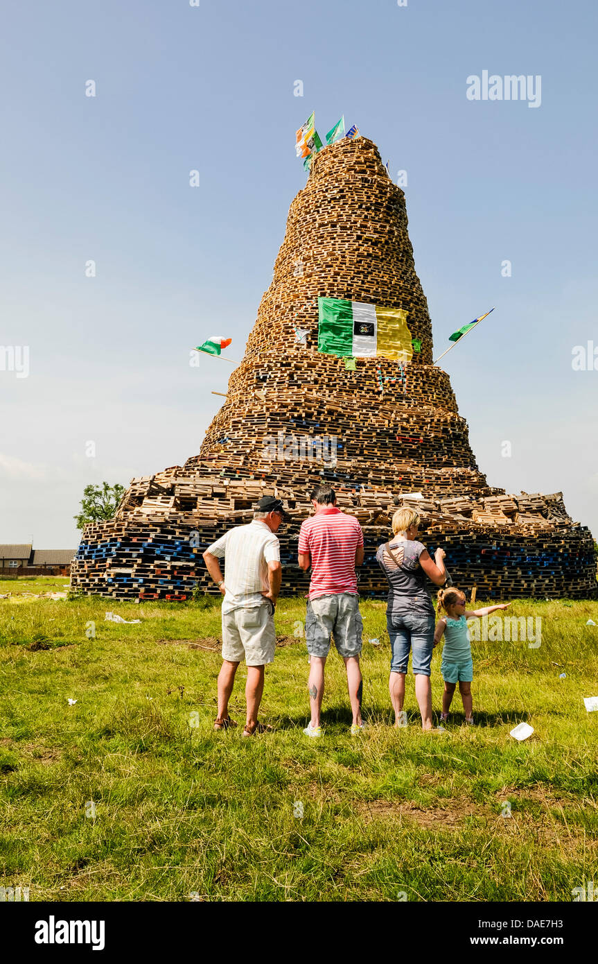Newtownabbey, Northern Ireland. 11th July 2013. People gather to see an enormous bonfire, estimated at over 30m Stock Photo