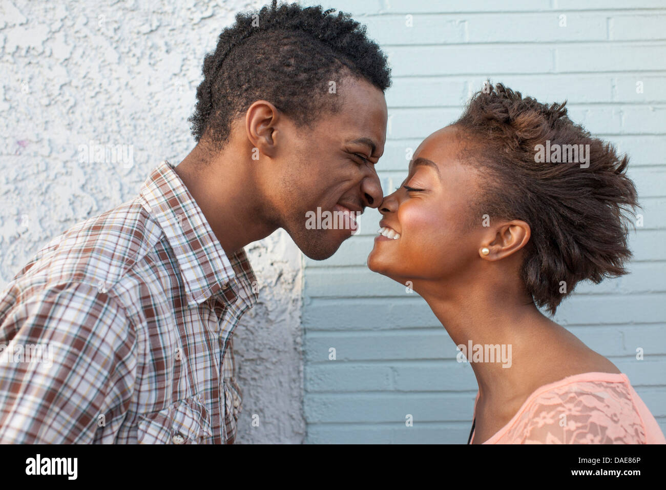 Young couple touching noses - Stock Image