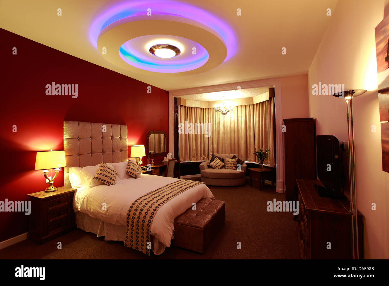 Interior Of A Hotel Bedroom With Ceiling Lights Double Bed And Soft Stock Photo Alamy