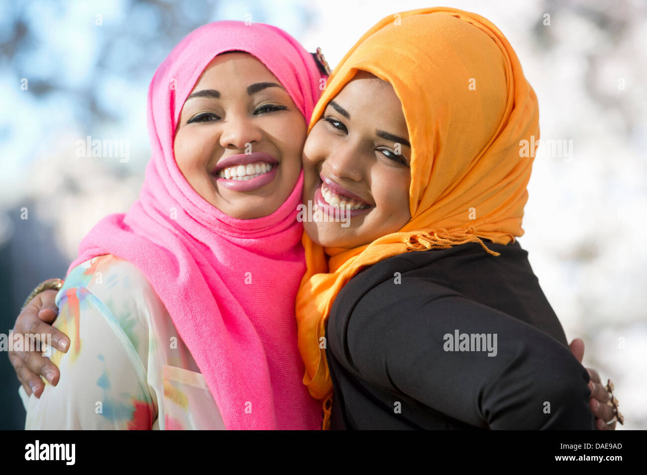 Close up portrait of two young woman in park - Stock Image