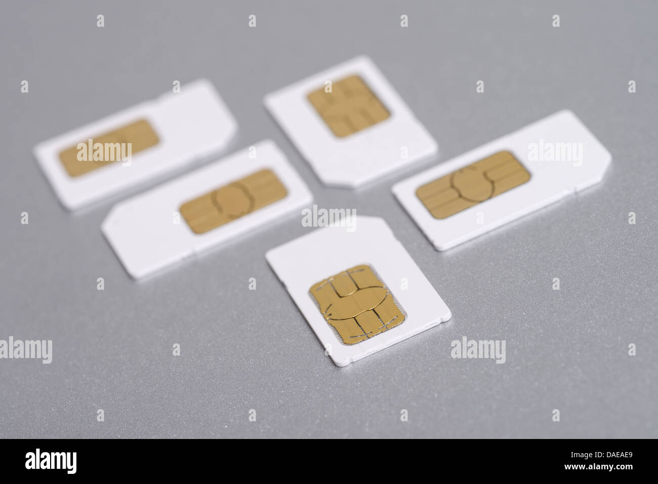 Five mobile phone full size SIM cards - Stock Image