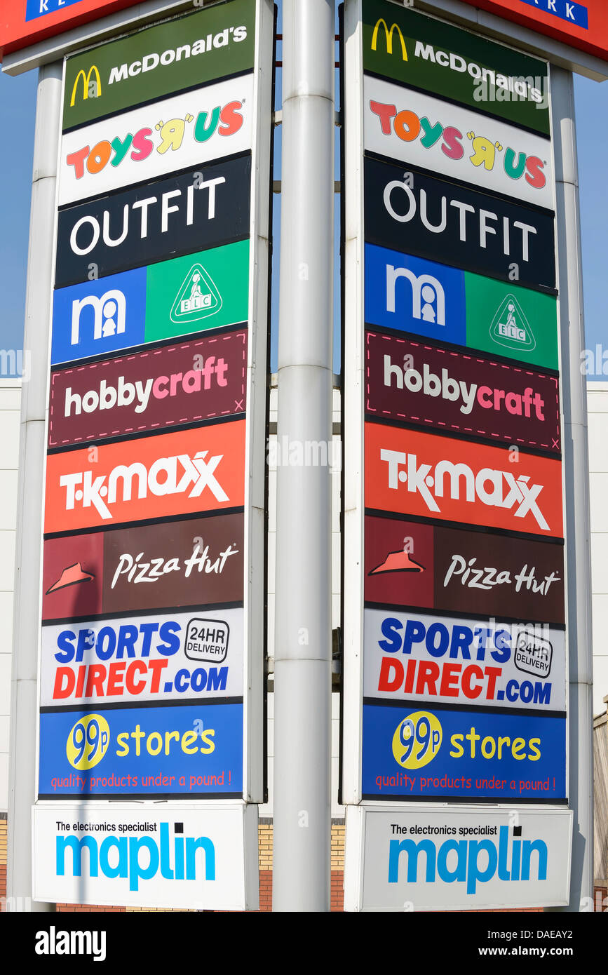 Signage for the shops at a retail park - Stock Image