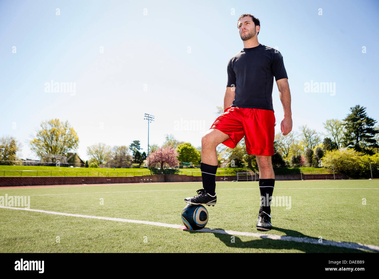Soccer player preparing for free kick - Stock Image