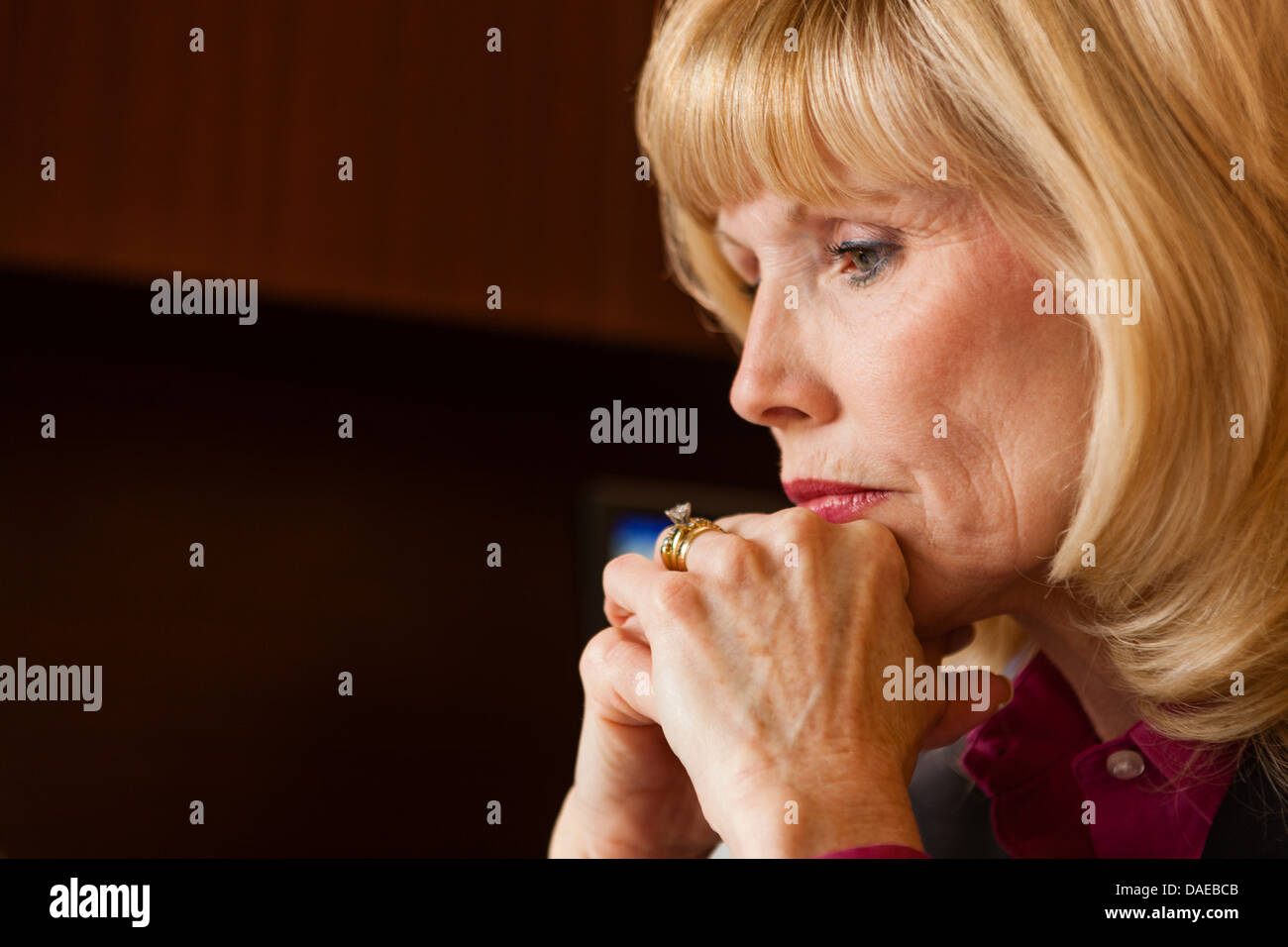 Close up portrait of mature woman looking pensive - Stock Image