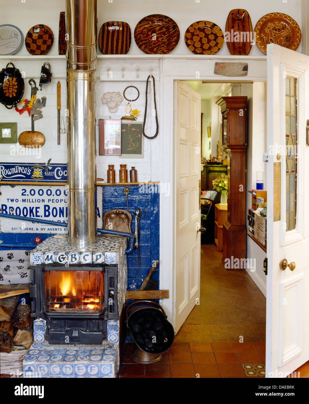 Well known Wood burning stove with blue+white tiled surround in country  YT93