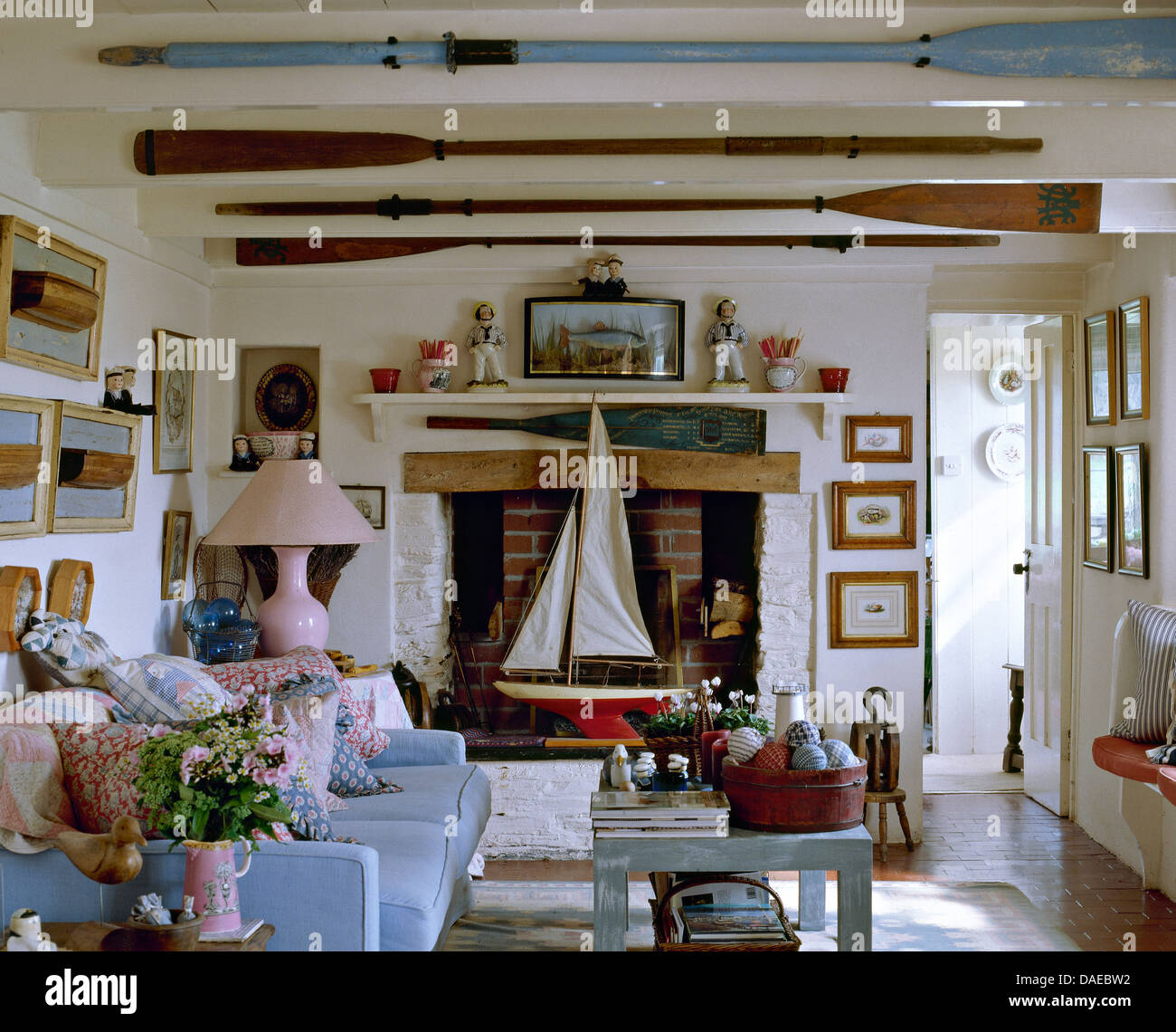 Old oars on ceiling beams in nautical themed cottage - Nautical theme living room ...