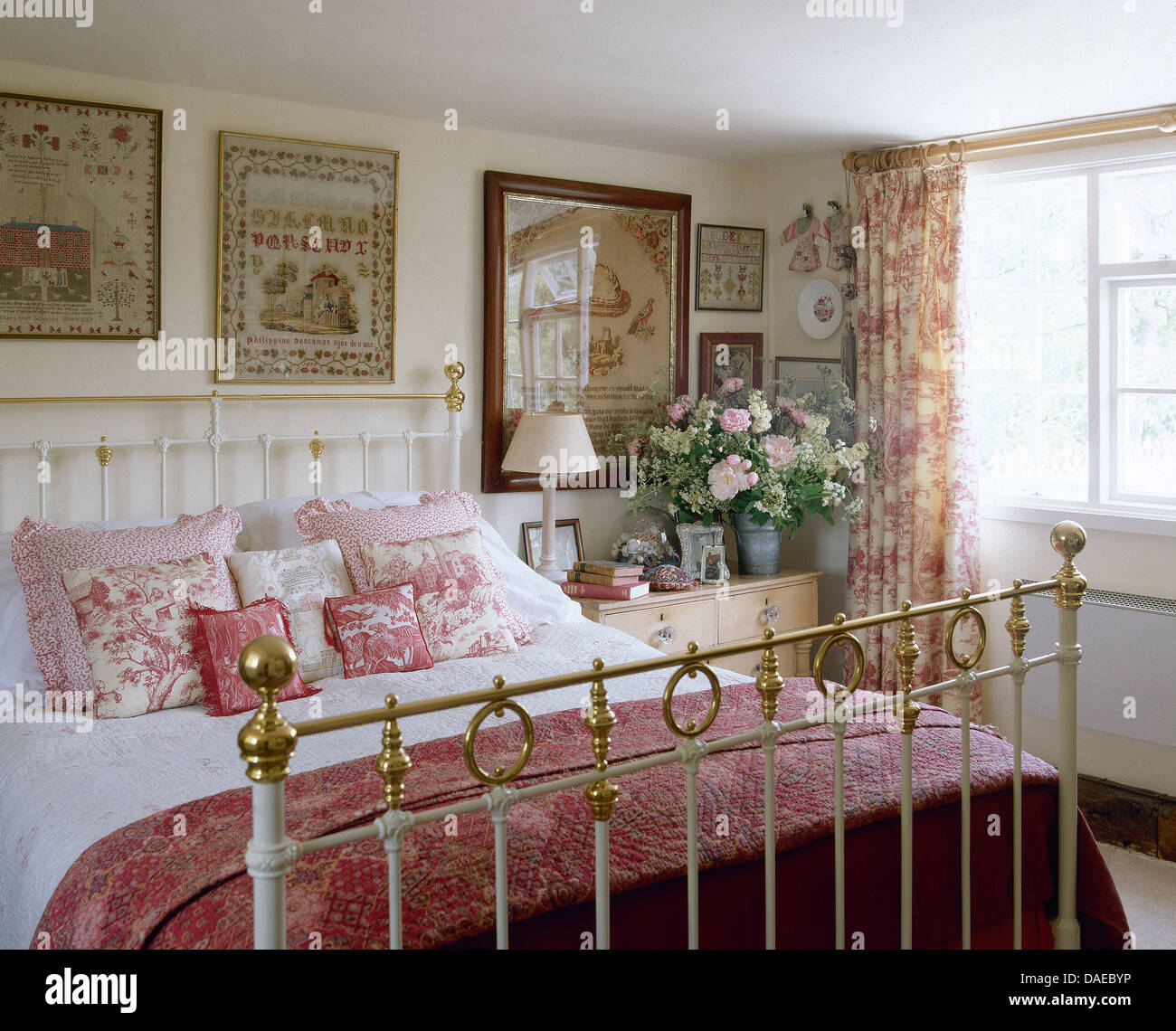 antique brass bed. Antique Samplers On Wall Above Brass Bed With Pink Quilt And Cushions In Cottage Bedroom Toile De Jouy Drapes