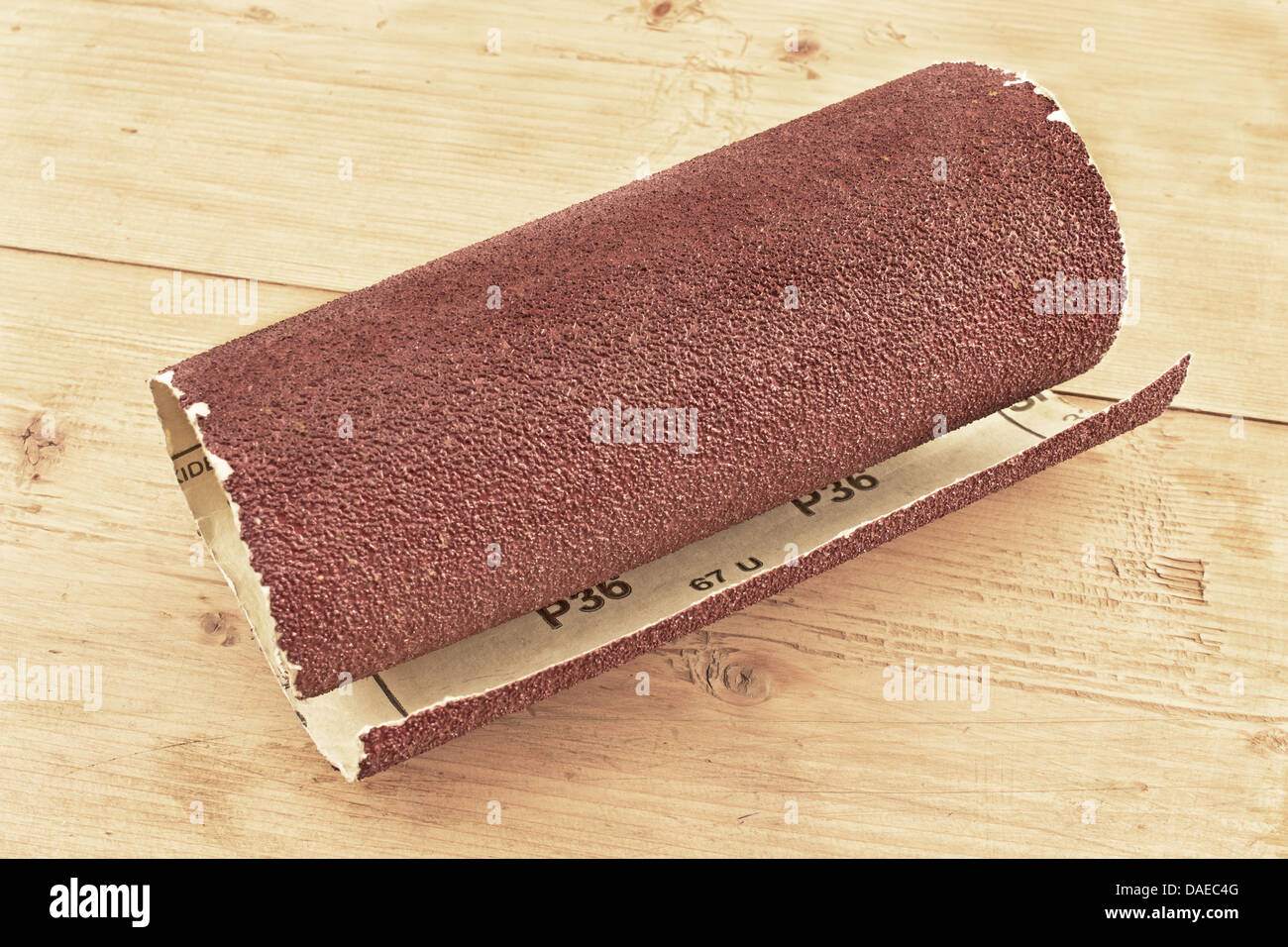 Emery paper - sandpaper on wooden board - Stock Image