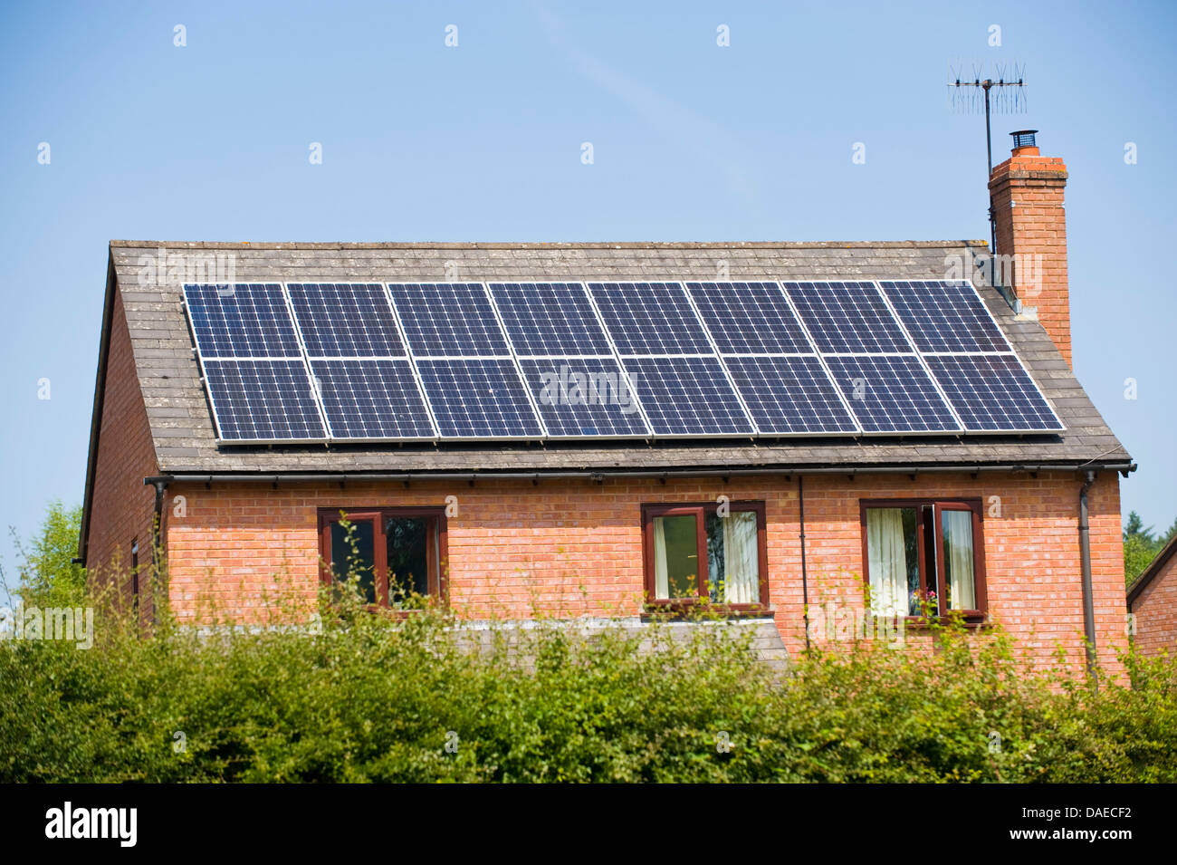 Solar panels on roof of modern detached house in rural village of Boughrood Powys Mid Wales UK - Stock Image