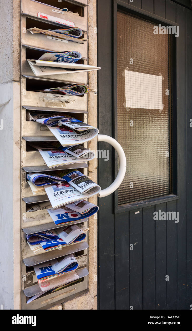 Mailboxes of apartment filled with advertising papers - Stock Image