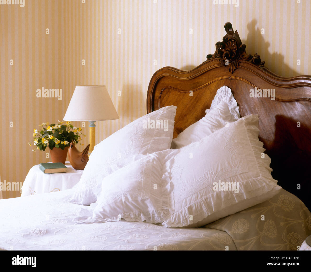 Lace Trimmed White Cushions On Antique Ed With Carved Wooden Stock Photo Alamy