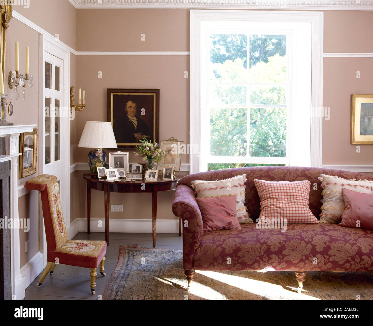 Patterned Cushions On Red Damask Sofa In Pink Country Sitting Room With  Antique Demi Lune