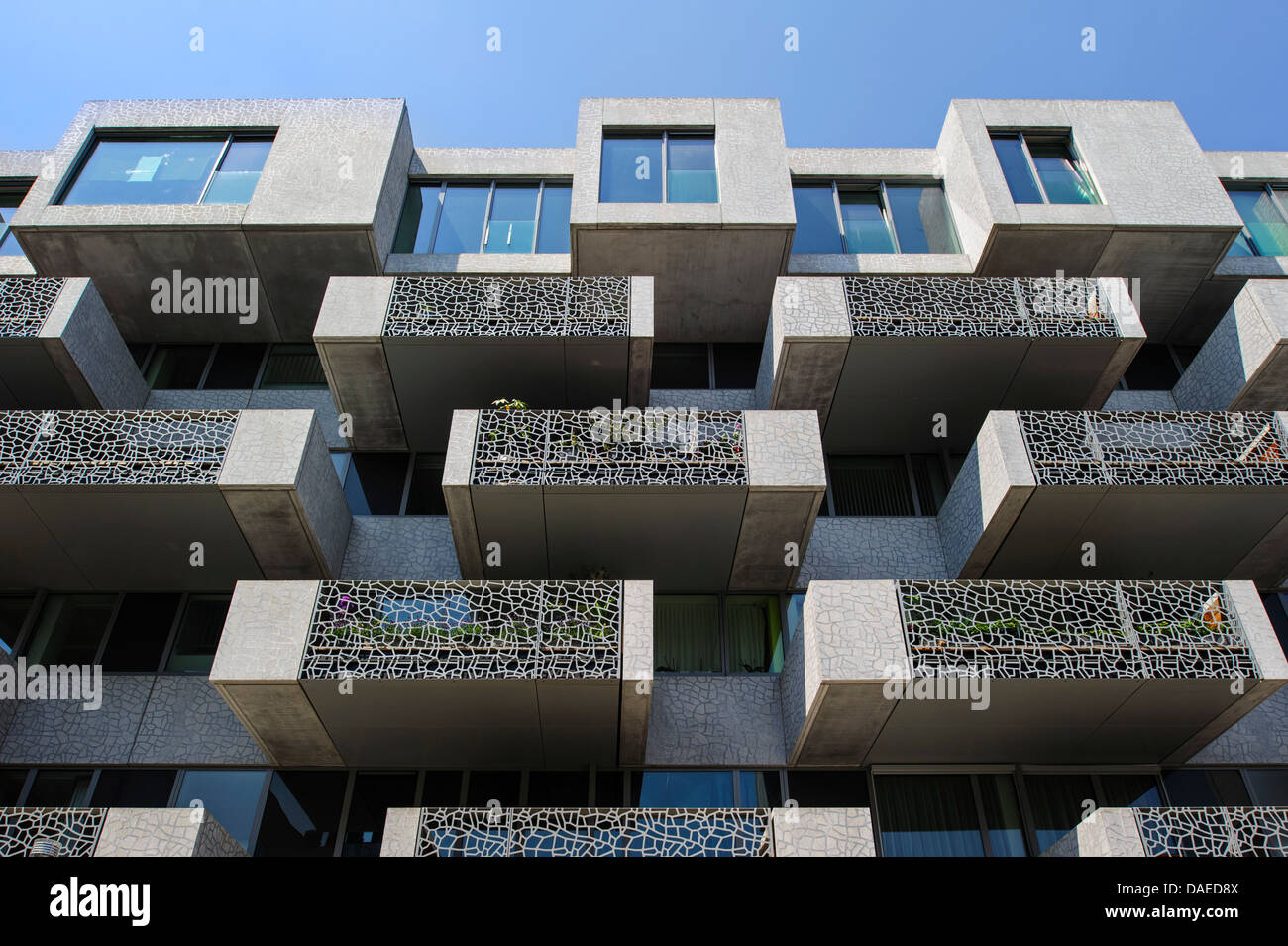 Modern flats with balconies of block of apartments in Leuven / Louvain, Belgium - Stock Image
