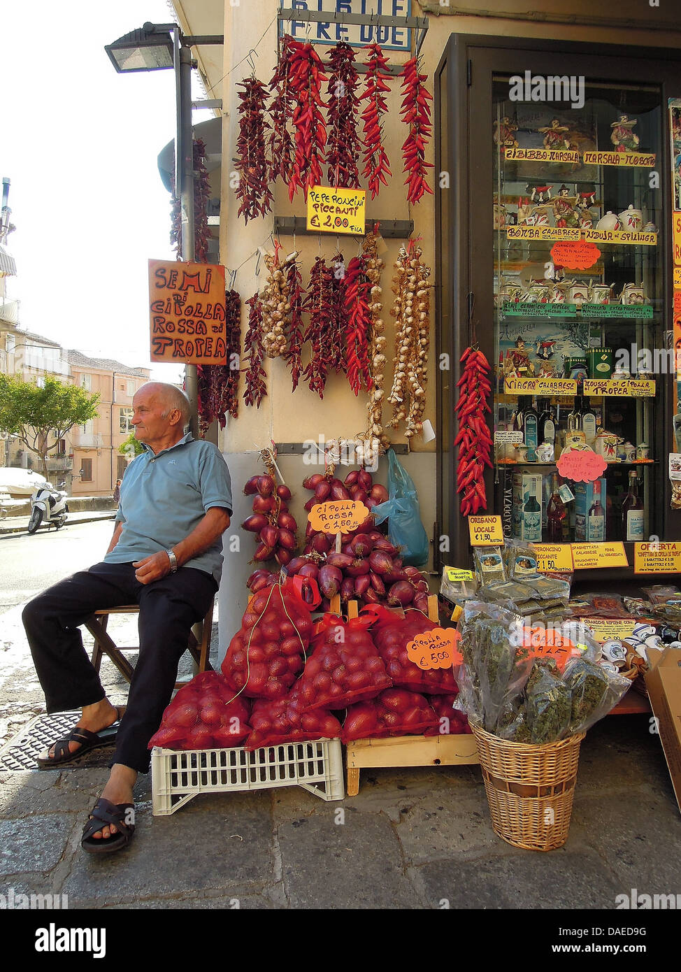 old man sitting in front of a store, Italy, Calabrien, Tropea Stock Photo