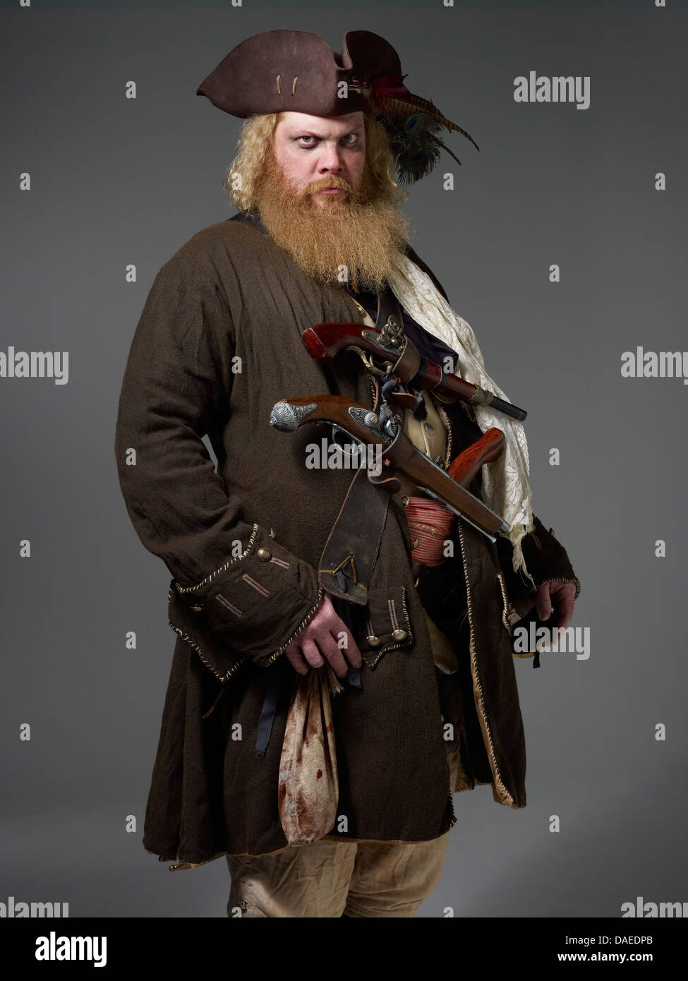Bearded Pirate with Two Guns Across Chest, Portrait - Stock Image