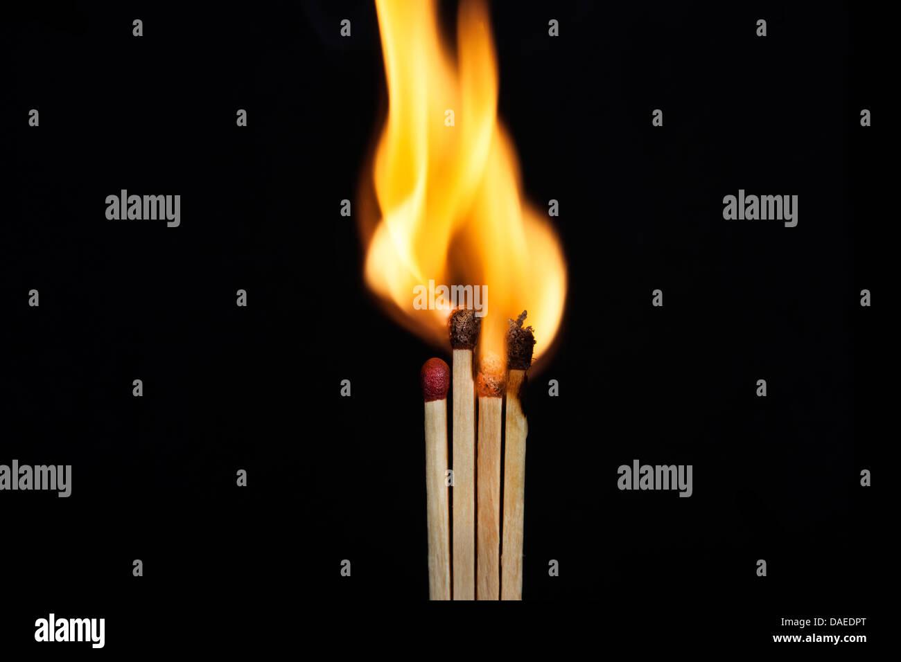 match flame matchstick black fire background blaze closeup stick light burning isolated nobody sulfur power yellow - Stock Image