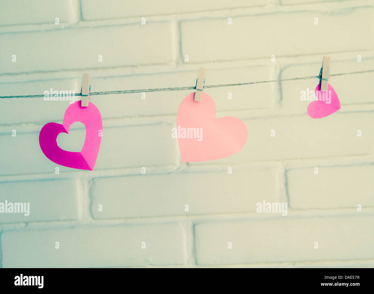 hearts with clothespin in vintage colors - Stock Image