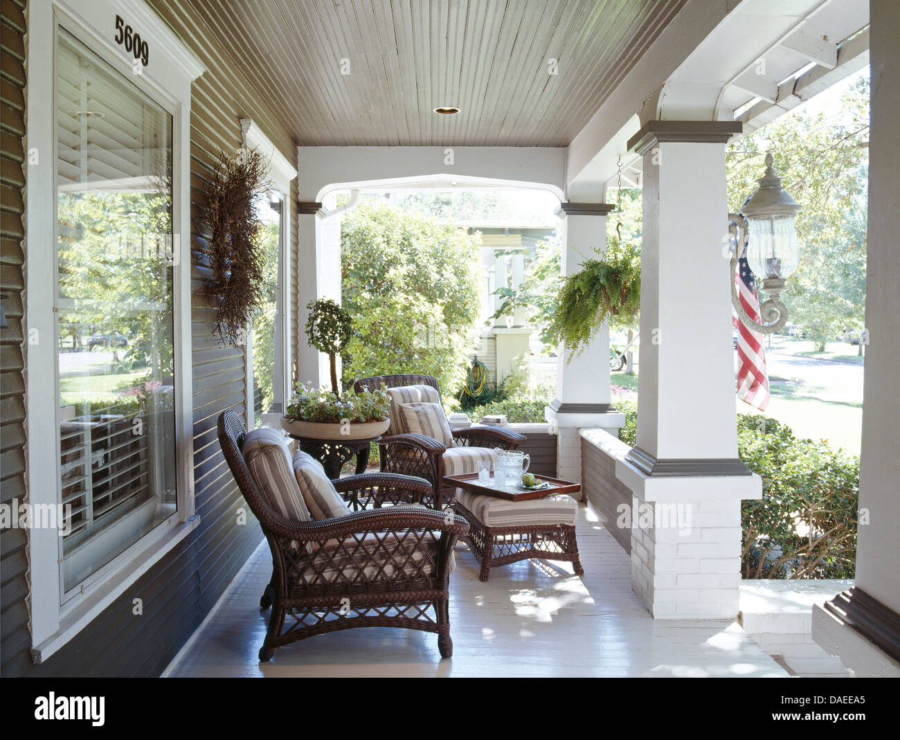 Wicker Armchairs On Veranda Of American Colonial Style
