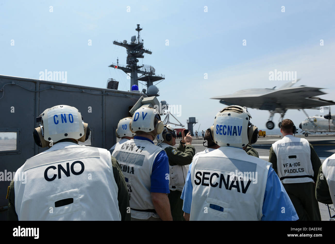 Chief of Naval Operations Adm. Jonathan Greenert, left, and Secretary of the Navy Ray Mabus watch a US Navy X-47B Stock Photo