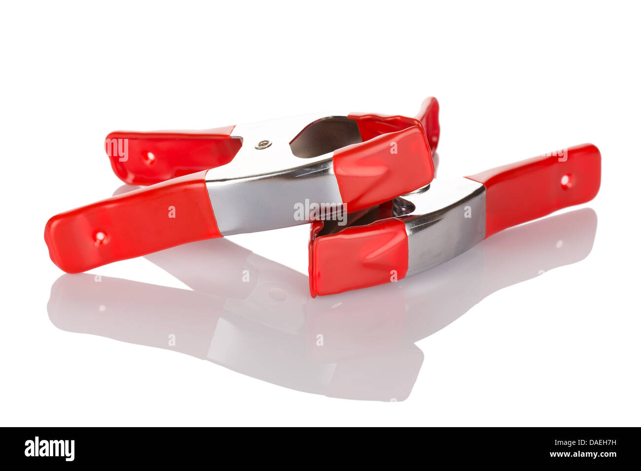 Red pliers. Manual tool. Isolated on white background close up. - Stock Image