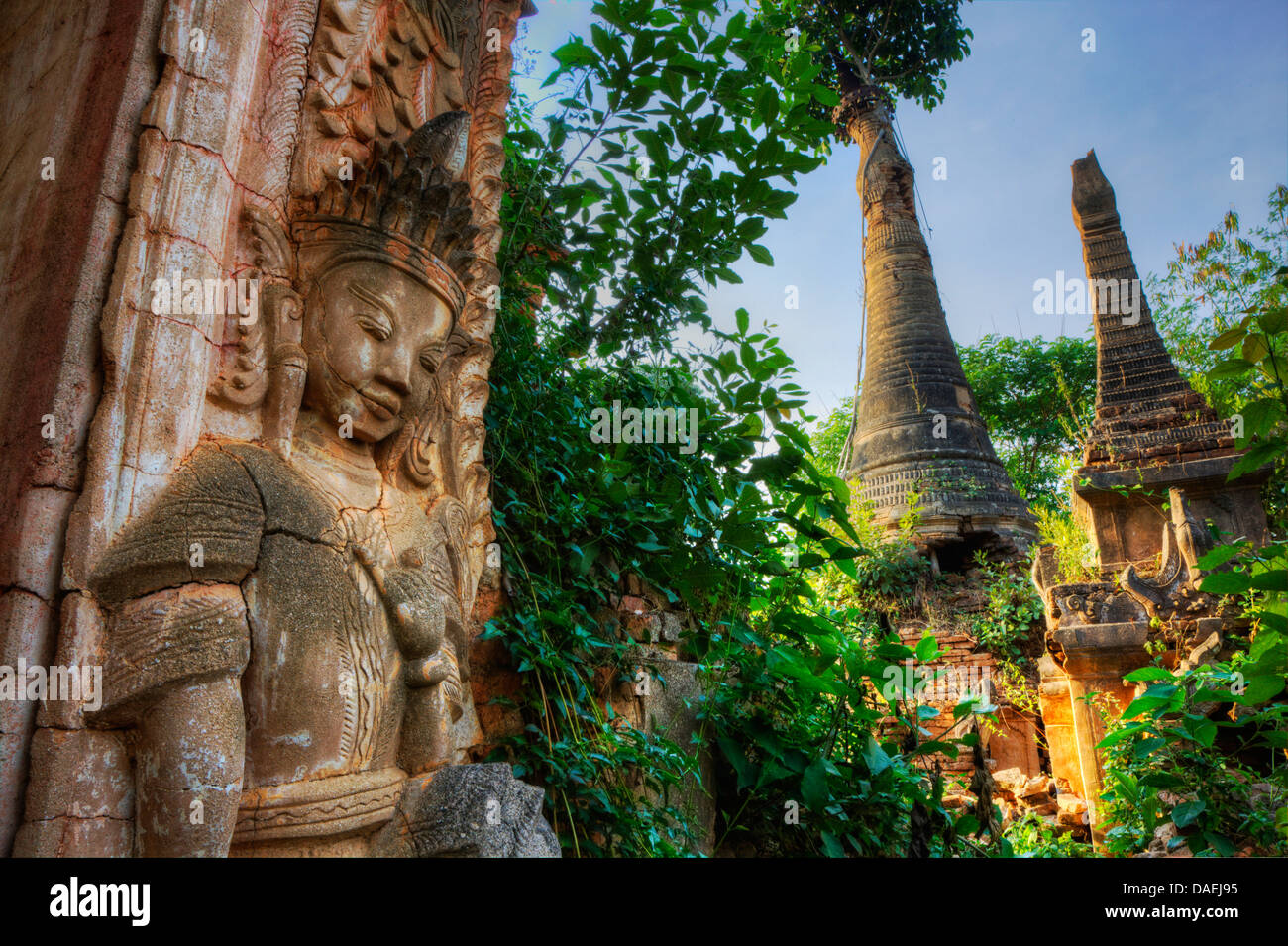 Stucco BUDDHIST DEITIES at NYAUNG OHAK located at INDEIN consisting of ancient SHRINES, INLE LAKE, Burma - Stock Image