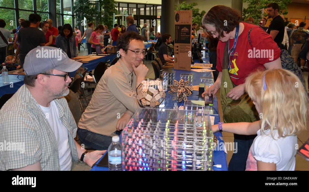 ANN ARBOR, MI - JUNE 8: Attendees explore the Hypnocube at the Ann Arbor Mini Maker Faire June 8, 2013 in Ann Arbor, - Stock Image
