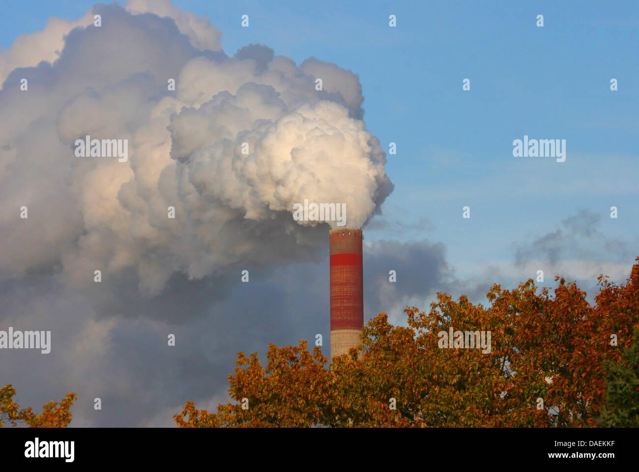 heavily smoking factory chimney, Germany, North Rhine-Westphalia, Ruhr Area Stock Photo