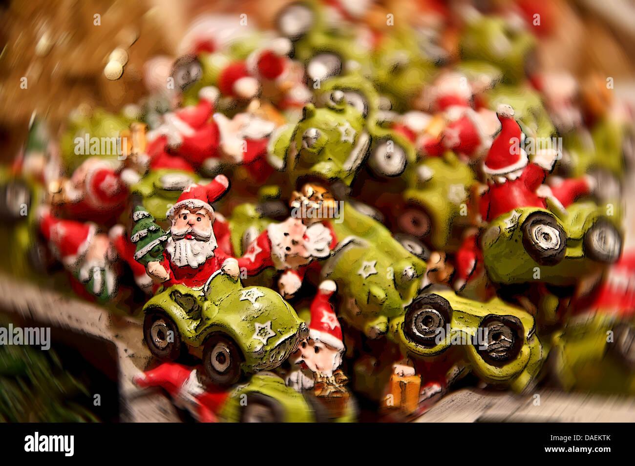 Pile of kitschy cheap Christmas ornaments depicting Santa Claus ...