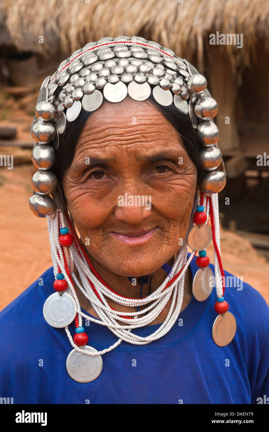 woman of the Akha tribe wearing an elaborate headdress made out of beads and silver coins , Burma, Kyaingtong/Kengtung - Stock Image