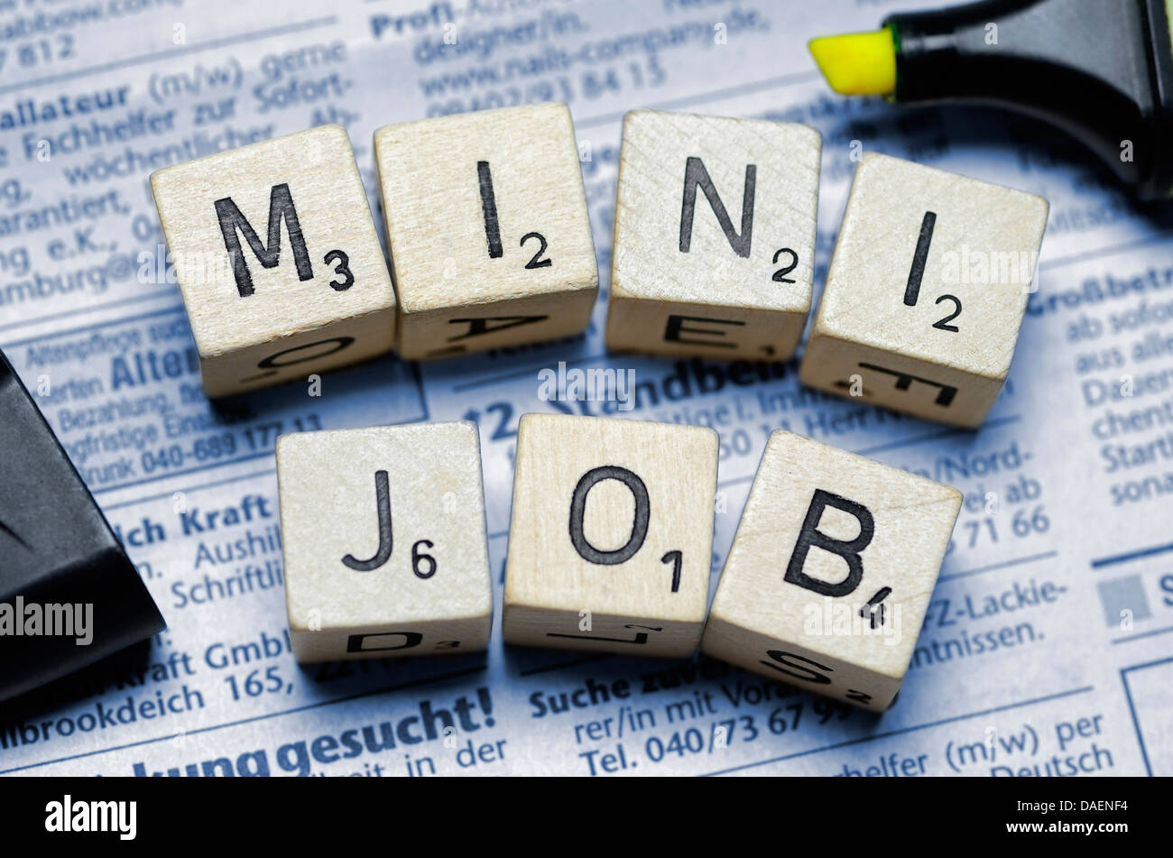 letter tokens forming the word minijob on job ads - Stock Image