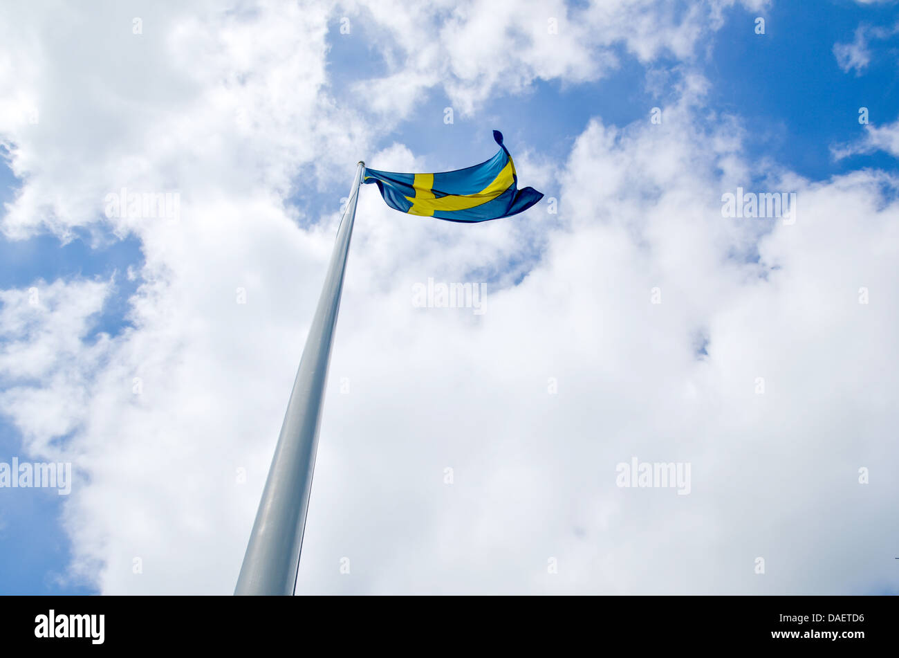Flag pole wita a swedish flag in the top. - Stock Image