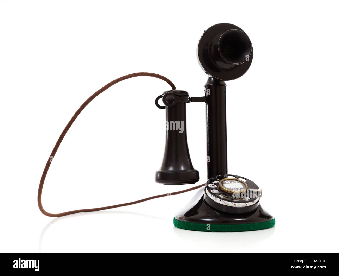 A black vintage candlestick phone on a white background with copy space - Stock Image