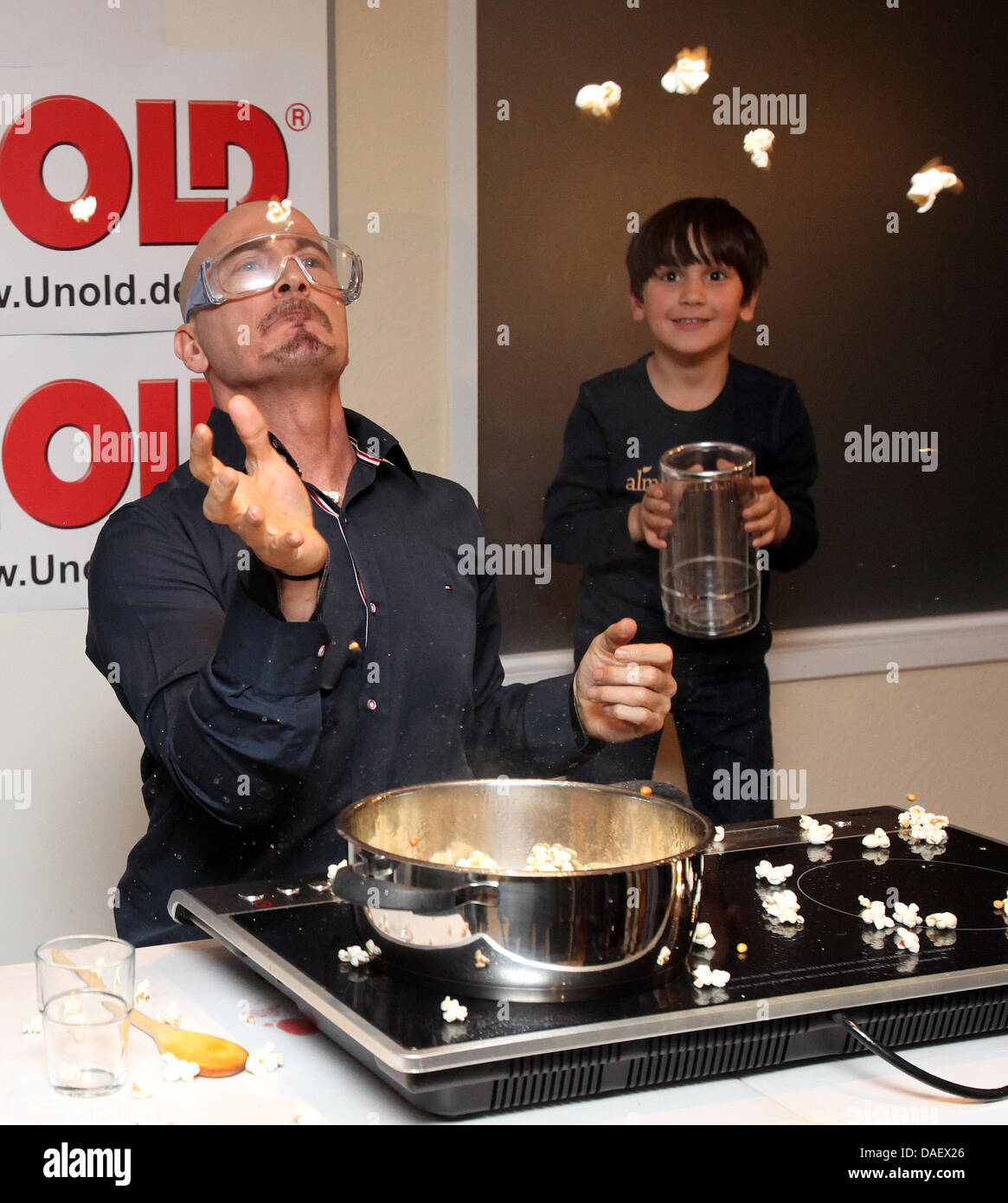 Stuntman Joe Alexander (L) tries to catche as many pieces of popcorn from the air as possible in one minute in Hamburg,Germany, - Stock Image