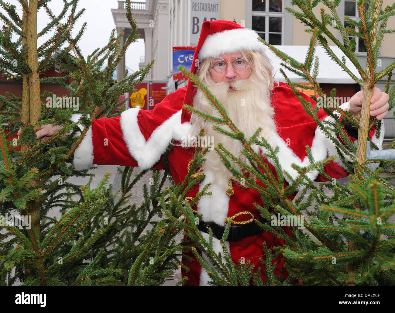 The Christmas Clause.A Man Dressed Up As Santa Clause Looks Through A Christmas