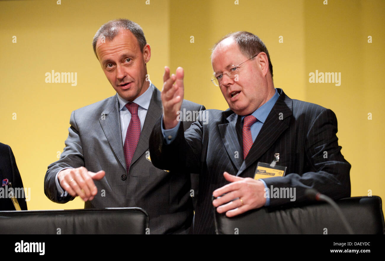 The supervisory boards Friedrich Merz (L) and Peer Steinbrueck talk during the general meeting of soccer club Borussia - Stock Image